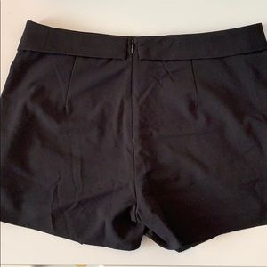 Mossimo Supply Co. Shorts - Black Mossimo skort with pockets. NWT. Size 12.